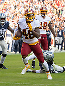 Washington Redskins running back Kapri Bibbs (46) breaks into the clear as he runs for a first quarter touchdown against the Dallas Cowboys at FedEx Field in Landover, Maryland on Sunday, October 21, 2018.<br /> Credit: Ron Sachs / CNP