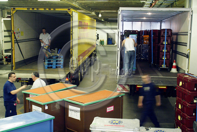 BRUSSELS - BELGIUM - 12 MAY 2006 -- Workers from the EU Parliament loading the trucks leaving for Strasbourg. 732 MEPs have offices in Strasbourg and Brussels. Every month they and their staff move between the 2 cities and uses this kind of boxes for the documents and other stuff. The MEP also calls it the commuting circus. PHOTO: ERIK LUNTANG / EUP-IMAGES