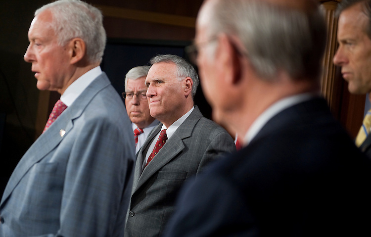 UNITED STATES - JUNE 30:  From left, Sens. Orrin Hatch, R-Utah, Mike Enzi, R-Wyo., Senate Minority Whip Jon Kyl, R-Ariz., Sens. Pat Roberts, R-Kan., and John Thune, R-S.D., conduct a news conference on their objections to the timing of a Senate Finance Committee markup of three trade agreements. (Photo By Tom Williams/Roll Call)