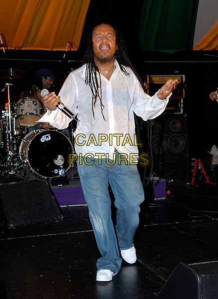 MAXIE PRIEST.In Jamaica..July 4th, 2006.Ref: FIN.full length white shirt jeans denim.www.capitalpictures.com.sales@capitalpictures.com.© Capital Pictures.