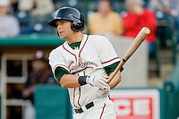 Kyle Jensen #22 of the Greensboro Grasshoppers follows through on his swing against the Delmarva Shorebirds at NewBridge Bank Park April 15, 2010, in Greensboro, North Carolina.  Photo by Brian Westerholt / Four Seam Images