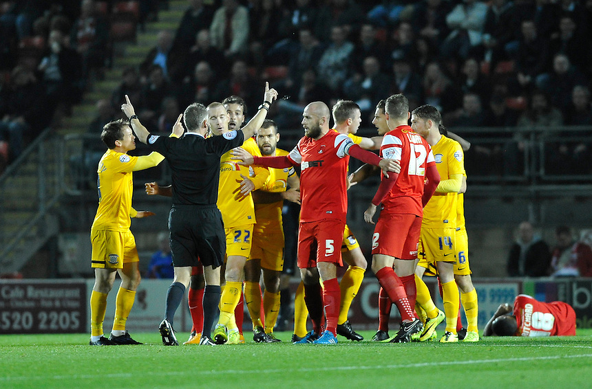 Tempers boil over in the first half leading to a yellow card for Preston North End's David Buchanan<br /> <br /> Photographer Ashley Western/CameraSport<br /> <br /> Football - The Football League Sky Bet League One - Leyton Orient v Preston North End - Tuesday 28th October 2014 - Matchroom Stadium - London<br /> <br /> &copy; CameraSport - 43 Linden Ave. Countesthorpe. Leicester. England. LE8 5PG - Tel: +44 (0) 116 277 4147 - admin@camerasport.com - www.camerasport.com