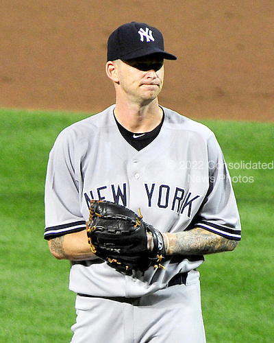 New York Yankees pitcher A.J. Burnett (34) reacts to J.J. Hardy's home run in the second inning against the Baltimore Orioles at Oriole Park at Camden Yards in Baltimore, MD on Friday, August 26, 2011.  Burnett was tagged for six runs in the inning..Credit: Ron Sachs / CNP.(RESTRICTION: NO New York or New Jersey Newspapers or newspapers within a 75 mile radius of New York City)