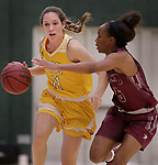 SPEARFISH, SD: NOVEMBER 11:  Racquel Wientjes #11 of Black Hills State drives agains Passionate Amukamara #5 of Texas A&M Kingsville during their game Saturday at the Donald E. Young Center in Spearfish, S.D.    (Photo by Dick Carlson/Inertia)