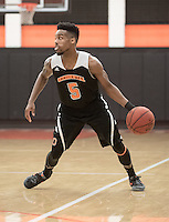 Jay Miller '17. The Occidental College men's basketball team plays against Pomona-Pitzer in Rush Gym on Feb. 16, 2017.<br /> (Photo by Marc Campos, Occidental College Photographer)