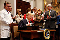 United States President Donald J. Trump participates in the signing ceremony for S. 2553 &quot;Know the Lowest Price Act&quot; and S. 2554 &quot;Patients Right to Know Drug Prices Act&quot;, in the Roosevelt Room of the White House, Washington, DC, October 10, 2018.<br /> CAP/MPI/RS<br /> &copy;RS/MPI/Capital Pictures