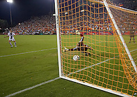 CF Pachuca defender Luis Gabriel Rey (18) takes a penalty kick as Houston Dynamo goalkeeper Pat Onstad (18) attempts to defend the goal.  CF Pachuca defeated Houston Dynamo 4-3 in penalty kicks after a 2-2 tie in regulation and extra time at Robertson Stadium in Houston, TX on August 14, 2007 in the SuperLiga semi-finals.