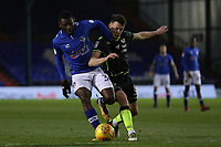 Oldham Athletic's Temitope Obadeyi (left) under pressure from Bristol Rovers' Ryan Sweeney (right) during the Sky Bet League 1 match between Oldham Athletic and Bristol Rovers at Boundary Park, Oldham, England on 30 December 2017. Photo by Juel Miah / PRiME Media Images.