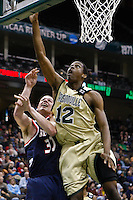 February 03, 2011:   Jacksonville Dolphins forward Shamile Jeffers (12) goes up for a layup over Belmont Bruins forward Trevor Noack (30) during Atlantic Sun Conference action between the Jacksonville Dolphins and the Belmont Bruins at Veterans Memorial Arena in Jacksonville, Florida.  Belmont defeated Jacksonville 76-70.