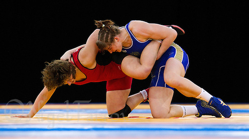 11 DEC 2011 - LONDON, GBR - Ekaterina Bukina (RUS) (in blue) attempts to overpower Zlateva Stanka (BUL) (in red) during the 72kg category final during the London International Wrestling Invitational and 2012 Olympic Games test event at the ExCel Exhibition Centre in London, Great Britain (PHOTO (C) NIGEL FARROW)