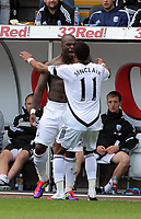 Pictured: Leroy Lita of Swansea (L)celebrating his goal with team mate Scott Sinclair (R). Saturday 17 September 2011<br /> Re: Premiership football Swansea City FC v West Bromwich Albion at the Liberty Stadium, south Wales.