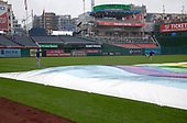 New York Mets starting pitcher Drew Gagnon (47), left, and relief pitcher Jacob Rhame (35) play catch in the rain near the tarp covering the infield prior to the scheduled game against the Washington Nationals at Nationals Park in Washington, D.C. on Sunday, September 23, 2018.<br /> Credit: Ron Sachs / CNP<br /> (RESTRICTION: NO New York or New Jersey Newspapers or newspapers within a 75 mile radius of New York City)