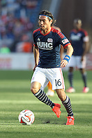 New England Revolution midfielder Daigo Kobayashi (16) dribbles. In a Major League Soccer (MLS) match, the New England Revolution (blue/white) defeated Houston Dynamo (orange), 2-0, at Gillette Stadium on April 12, 2014.