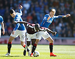 Morgaro Gomis tackled by Dean Shiels and Haris Vuckic