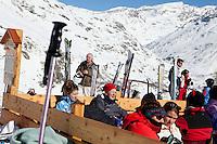 Diners on the terrace of ski slope restaurant Le Criou, Bonneval sur Arc, Savoie, France, 17 February 2012.