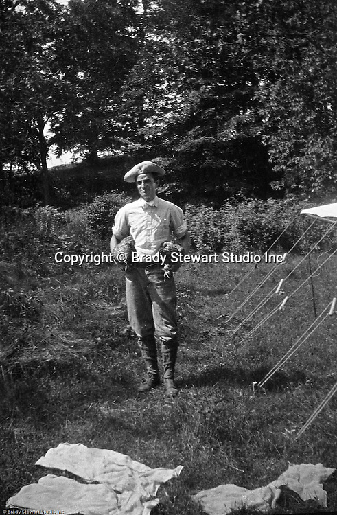 Gettysburg PA: View of Brady Stewart getting dinner ready while camping at Gettysburg. Brady Stewart was in Gettysburg with the Pittsburgh-area Boy's Brigade. They were in Gettysburg for 40th anniversary of the battle of Gettysburg. The Boy's Brigade was a church-based youth organization started in the late 1800s in Scotland - 1903