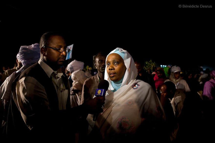 26 april 2010 - Karthoum, Sudan - A NCP supporter talk to the press after the final results of presidential elections was announced. Sudan's president Omar al-Bashir won another term in office Monday, according to election officials, with a comfortable majority (68 percent of the vote ) in elections marred by boycotts and fraud allegations, becoming the first leader to be elected while facing an international arrest warrant for alleged crimes he orchestrated in the western region of Darfur. The elections take place as Sudan heads toward a referendum in eight months that could lead South Sudan to split off and become Africa's newest nation. Photo credit: Benedicte Desrus