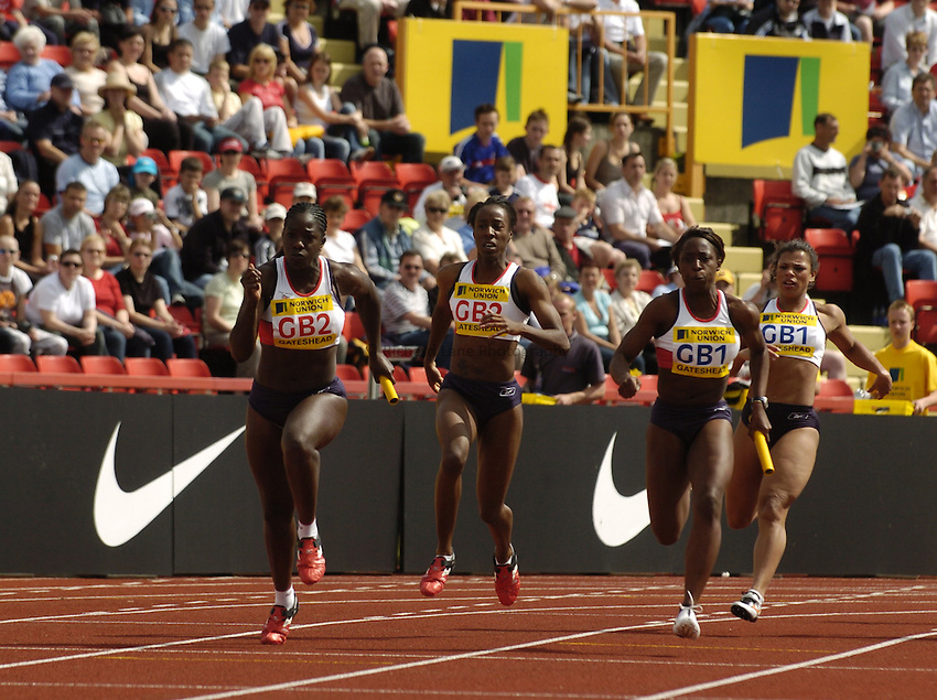 Photo. Jed Wee..Norwich Union British Grand Prix, 27/06/2004..British women's 100m relay teams (lt to rt) Abi Onuora, Sabrina Scott, Jeanette Kwakye and Diane Allahgreen with Nike and Norwich Union boards.