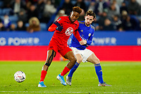 4th January 2020; King Power Stadium, Leicester, Midlands, England; English FA Cup Football, Leicester City versus Wigan Athletic; Jamal Lowe of Wigan Athletic holds off Ben Chilwell of Leicester City - Strictly Editorial Use Only. No use with unauthorized audio, video, data, fixture lists, club/league logos or 'live' services. Online in-match use limited to 120 images, no video emulation. No use in betting, games or single club/league/player publications