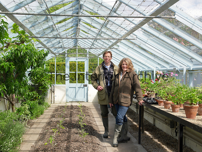 Owners Mark and Jo Blythe in the greenhouse of Blewbury Manor
