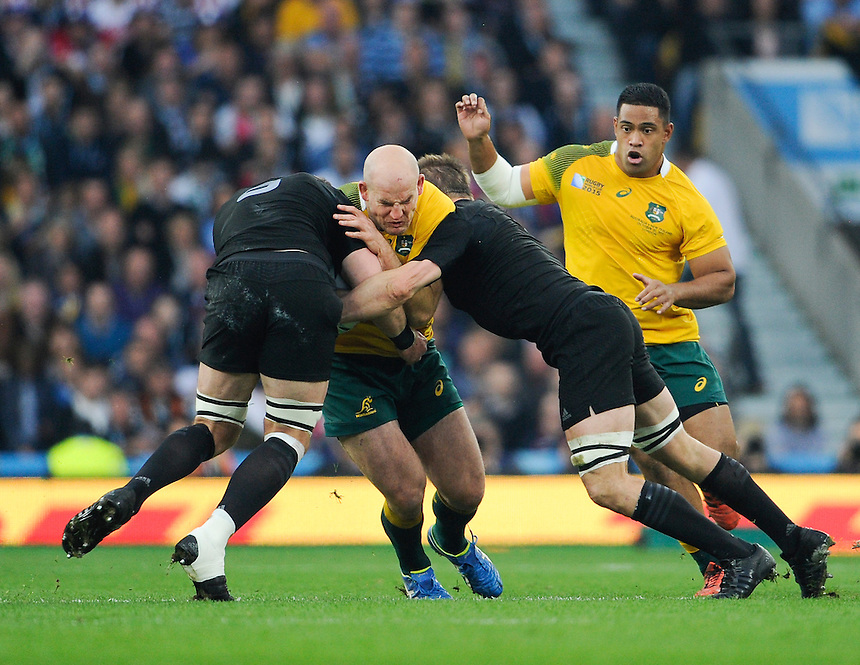 Australia's Stephen Moore is tackled by New Zealand's Kieran Read and Richie McCaw<br /> <br /> Photographer Ashley Western/CameraSport<br /> <br /> Rugby Union - 2015 Rugby World Cup Final - New Zealand v Australia - Saturday 31st October 2015 - Twickenham - London<br /> <br /> &copy; CameraSport - 43 Linden Ave. Countesthorpe. Leicester. England. LE8 5PG - Tel: +44 (0) 116 277 4147 - admin@camerasport.com - www.camerasport.com