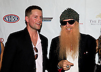 Aug. 29, 2013; Avon, IN, USA: ZZ Top guitarist/vocalist Billy Gibbons (right) with actor Richard Blake on the red carpet with wife Gilligan Stillwater prior to the premiere of Snake & Mongoo$e at the Regal Shiloh Crossing Stadium 18. Mandatory Credit: Mark J. Rebilas-