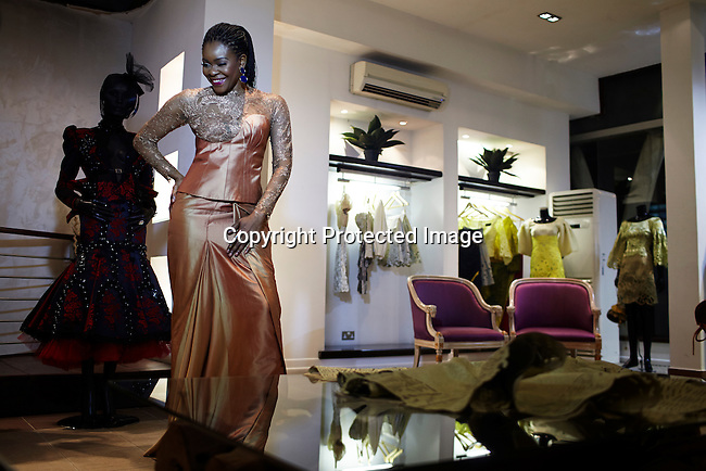 LAGOS, NIGERIA MAY 24: Nigerian fashion designer Deola Sagoe prepares poses during a photo shoot in her flagship store on May 24, 2013 on Victoria Island in Lagos, Nigeria. Deola is one of the best and celebrated local designers and she has shown her designs around Africa and the world. (Photo by: Per-Anders Pettersson)