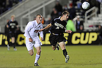 Wake Forest Demon Deacons Anthony Arena (3) heads the ball away from Virginia Cavaliers Will Bates (25) during the first semi-final match of the 2009 NCAA Men's College Cup at WakeMed Soccer Park in Cary, NC on December 11, 2009.