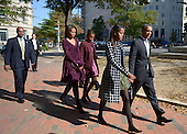 United States President Barack Obama with walks with his wife Michelle Obama (L) and two daughters Malia Obama (2R) and Sasha Obama (2L) from St. John's Church to the White House after service in Washington, DC, USA, 27 October 2013.<br /> Credit: Shawn Thew / Pool via CNP