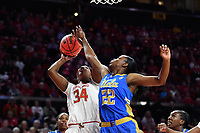 College Park, MD - March 25, 2019: Maryland Terrapins forward Brianna Fraser (34) goes up for a layup against UCLA Bruins guard Kennedy Burke (22)  during second round game of NCAAW Tournament between UCLA and Maryland at Xfinity Center in College Park, MD. UCLA advanced to the Sweet 16 defeating Maryland 85-80.(Photo by Phil Peters/Media Images International)
