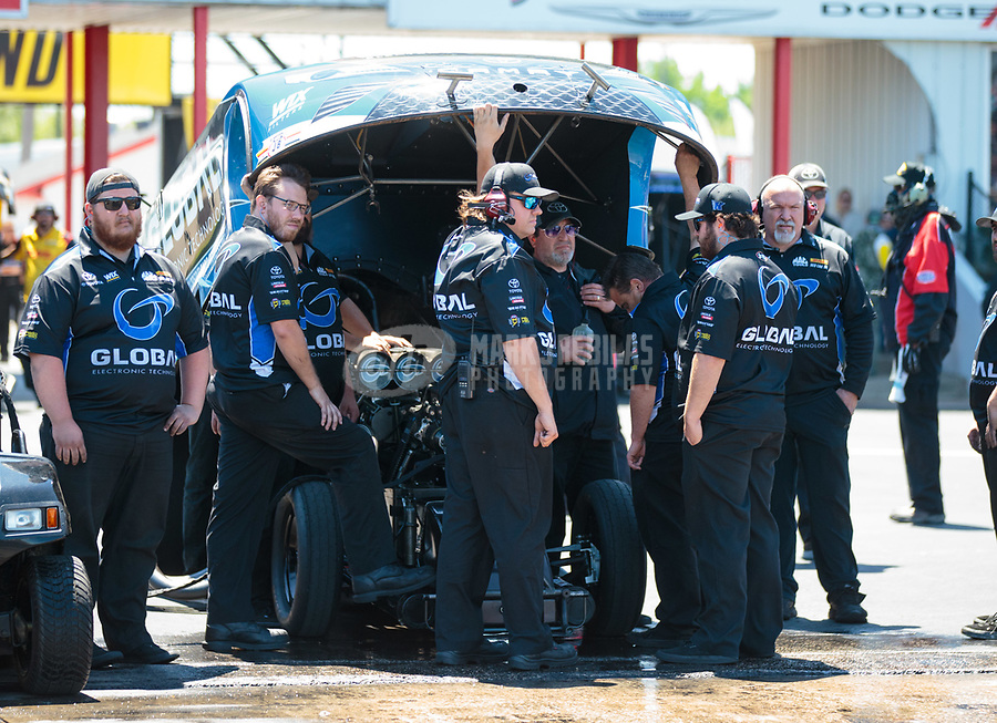 Apr 14, 2019; Baytown, TX, USA; Crew members for NHRA funny car driver Shawn Langdon during the Springnationals at Houston Raceway Park. Mandatory Credit: Mark J. Rebilas-USA TODAY Sports