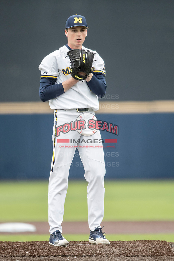 Michigan Wolverines pitcher Tommy Henry (47) looks to his catcher for the sign against the Maryland Terrapins on April 13, 2018 in a Big Ten NCAA baseball game at Ray Fisher Stadium in Ann Arbor, Michigan. Michigan defeated Maryland 10-4. (Andrew Woolley/Four Seam Images)