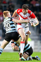 Picture by Alex Whitehead/SWpix.com - 01/05/2014 - Rugby League - First Utility Super League - St Helens v London Broncos - Langtree Park, St Helens, England - St Helens' Alex Walmsley is tackled by London's James Cunningham and Olsi Krasniqi.