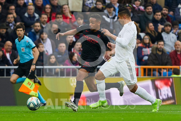 Carlos Henrique Casemiro of Real Madrid and Fernando Reges of Sevilla FC during La Liga match between Real Madrid and Sevilla FC at Santiago Bernabeu Stadium in Madrid, Spain. January 18, 2020. (ALTERPHOTOS/A. Perez Meca)