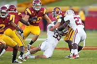 LOS ANGELES, CA-OCTOBER 29,2011- Stanford defeated USC 56-48. Jarek Lancaaster (35) and Johnson Bademosi (27) come up big with a tackle. during play against USC at the L.A. Coliseum in Los Angeles, CA.