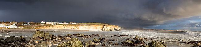 Shot during early March 2014, this Freshwater Bay Surfing Panorama captures surfing action at the bay as a Storm front passes overhead on the Isle of Wight.