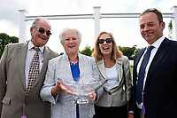 Connections of Cotton Club receive their trophy for winning The Bathwick Tyres Handicap, during Afternoon Racing at Salisbury Racecourse on 13th June 2017