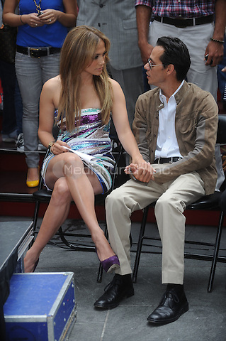 Jennifer Lopez and Marc Anthony at the unveiling of the 'Be Extraordinary' billboard for the Boys & Girls Clubs Youth Advocacy Campaign in Times Square in New York City. June 10, 2010 Credit: Dennis Van Tine/MediaPunch