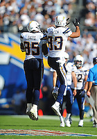Sep. 20, 2009; San Diego, CA, USA; San Diego Chargers wide receiver (85) Antonio Gates celebrates with (83) Vincent Jackson after Jackson scored a touchdown against the Baltimore Ravens at Qualcomm Stadium in San Diego. Baltimore defeated San Diego 31-26. Mandatory Credit: Mark J. Rebilas-