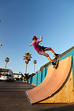 USA, California, San Diego, skateboarder rides up a ramp near Ocean Beach