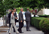 12 June 2005 – Washington, DC – President George W. Bush travels to the St. John's Church to attend Sunday Mass. He stands at the door of the church speaking with Reverend Dr. Luis Leon.<br /> Credit: Gary Fabiano - Pool via CNP