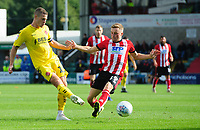 Fleetwood Town's Paul Coutts vies for possession with Lincoln City's Joe Morrell<br /> <br /> Photographer Chris Vaughan/CameraSport<br /> <br /> The EFL Sky Bet League One - Lincoln City v Fleetwood Town - Saturday 31st August 2019 - Sincil Bank - Lincoln<br /> <br /> World Copyright © 2019 CameraSport. All rights reserved. 43 Linden Ave. Countesthorpe. Leicester. England. LE8 5PG - Tel: +44 (0) 116 277 4147 - admin@camerasport.com - www.camerasport.com