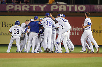 South Bend Cubs Carlos Sepulveda (2) is mobbed by teammates, including Bryant Flete (13), Preston Morrison (19), John Williamson (20), and Matt  Rose (17) after a walk off hit during a game against the Burlington Bees on July 22, 2016 at Four Winds Field in South Bend, Indiana.  South Bend defeated Burlington 4-3.  (Mike Janes/Four Seam Images)
