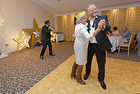 Pictured: One of the lottery winners (R) dances with a female guest. Wednesday 28 November 2018<br /> Re: National Lottery millionaires from south Wales and the south west of England have hosted a glitzy Rat Pack-inspired Christmas party for an older people's music group at The Bear Hotel in Cowbridge, Wales, UK.