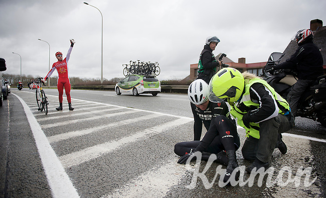 Florian Senechal (FRA/Cofidis) signals for his teamcar after a crash, while Giacomo Nizzolo (ITA/Trek Factory Racing) is attended by the moto medic<br /> <br /> 70th Dwars Door Vlaanderen 2015