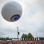 © Joel Goodman - 07973 332324 . 20/07/2013 . Suffolk , UK . A gigantic inflatable eyeball is launched in to the crowd as Yeah Yeah Yeahs perform on the Obelisk Stage . The Latitude music and culture festival in Henham Park , Southwold . Photo credit : Joel Goodman