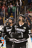 Noel Acciari (PC - 24), Kevin Rooney (PC - 21) - The Providence College Friars defeated the Boston University Terriers 4-3 to win the national championship in the Frozen Four final at TD Garden on Saturday, April 11, 2015, in Boston, Massachusetts.