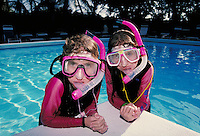 Children in diving gear snorkeling at poolside. Children. Douglaston NY.