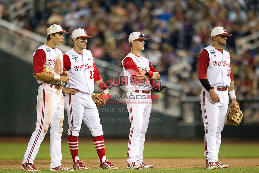 North Carolina State infielders Trea Turner (8), Grant Clyde (22), Logan Ratledge (6) and Tarran Senay (32) during during a pitching change in Game 10 of the 2013 Men's College World Series against the North Carolina Tar Heels on June 20, 2013 at TD Ameritrade Park in Omaha, Nebraska. The Tar Heels defeated the Wolfpack 7-0, eliminating North Carolina State from the tournament. (Andrew Woolley/Four Seam Images)