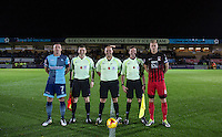 Captains Garry Thompson of Wycombe Wanderers & Andy Rose of Coventry City line up with Referee Charles Breakspear & his officials during the The Checkatrade Trophy Southern Group D match between Wycombe Wanderers and Coventry City at Adams Park, High Wycombe, England on 9 November 2016. Photo by Andy Rowland.